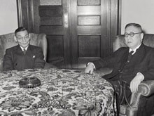借金名人百けん先生、一万田日銀総裁を訪問